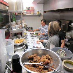 The team works on the dishes for the ChowDownTown.