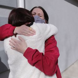 Cindy Lampropoulos, left, hugs Allisa Allen during a welcome home celebration for Vietnam veteran Warren Craig Eby, Lampropoulos' uncle and Allen's father, in Saratoga Springs on Friday, Nov. 13, 2020. Eby was hospitalized for seven weeks with COVID-19