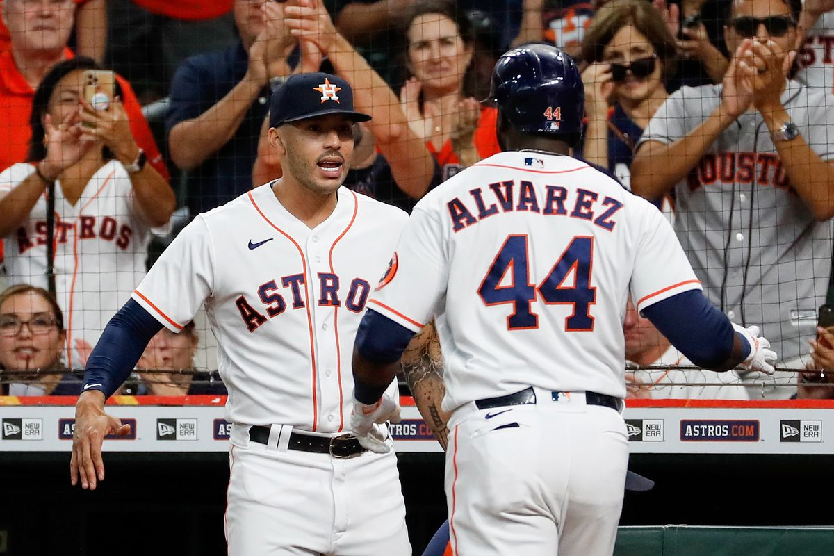 Carlos Correa #1 of the Houston Astros congratulates Yordan Alvarez #44 after a three run home run in the first inning against the Oakland Athletics at Minute Maid Park on October 02, 2021 in Houston, Texas.