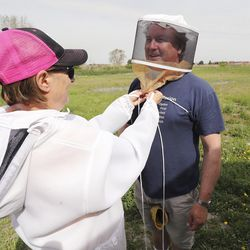 Volunteers Steve and Kristen Bell suit up to protect against bees at Ogden First United Methodist Church in Marriott-Slaterville, Weber County, on Tuesday, May 12, 2020. The church has an 11-acre property with a community garden and beehives, which provides fresh vegetables and honey to church members and Ogden's Lantern House homeless shelter.