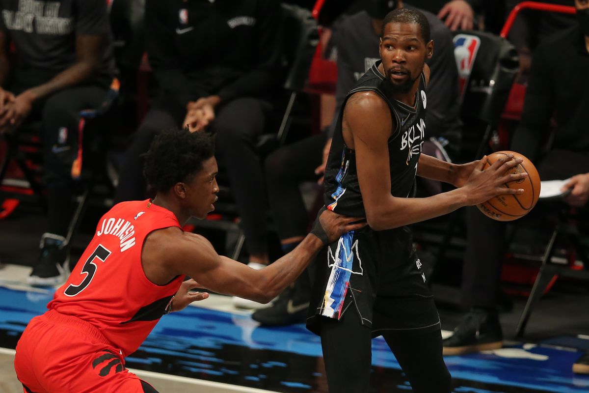 Brooklyn Nets power forward Kevin Durant (7) controls the ball against Toronto Raptors small forward Stanley Johnson (5) during the second quarter at Barclays Center.