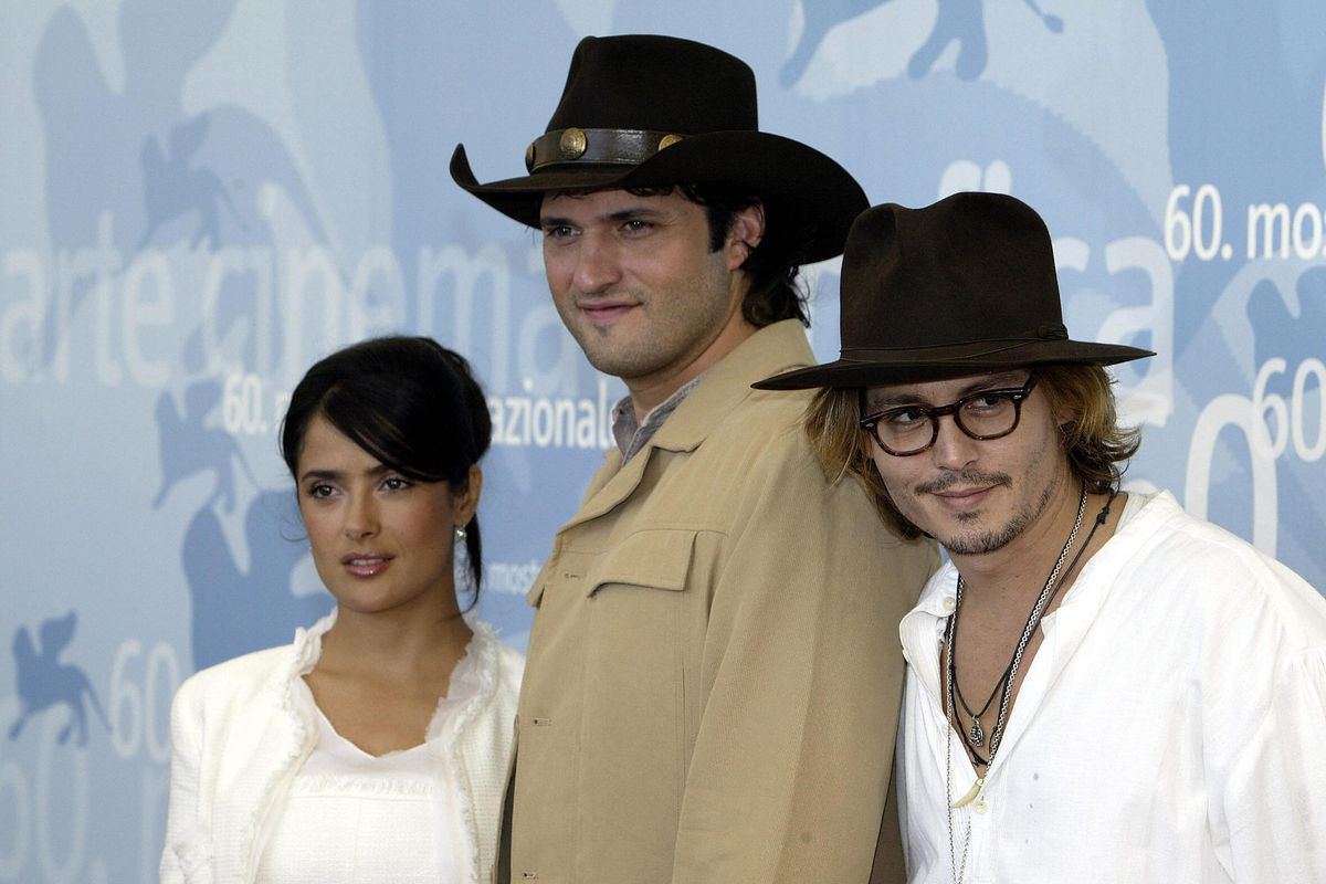 US actor Johnny Depp (R) poses for photo