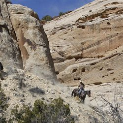 Bobby Lee Thompson, left, and Kash Winn ride down an old silver mine tailing while riding horses down the Little Grand Canyon of the San Rafael Swell  Saturday, April 2, 2011, in the San Rafael Swell in Central Utah.