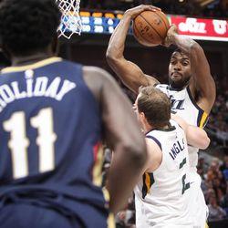 Utah Jazz forward Derrick Favors (15) pulls down a rebound as Utah hosts New Orleans at Vivint Arena in Salt Lake on Friday, Dec. 1, 2017.