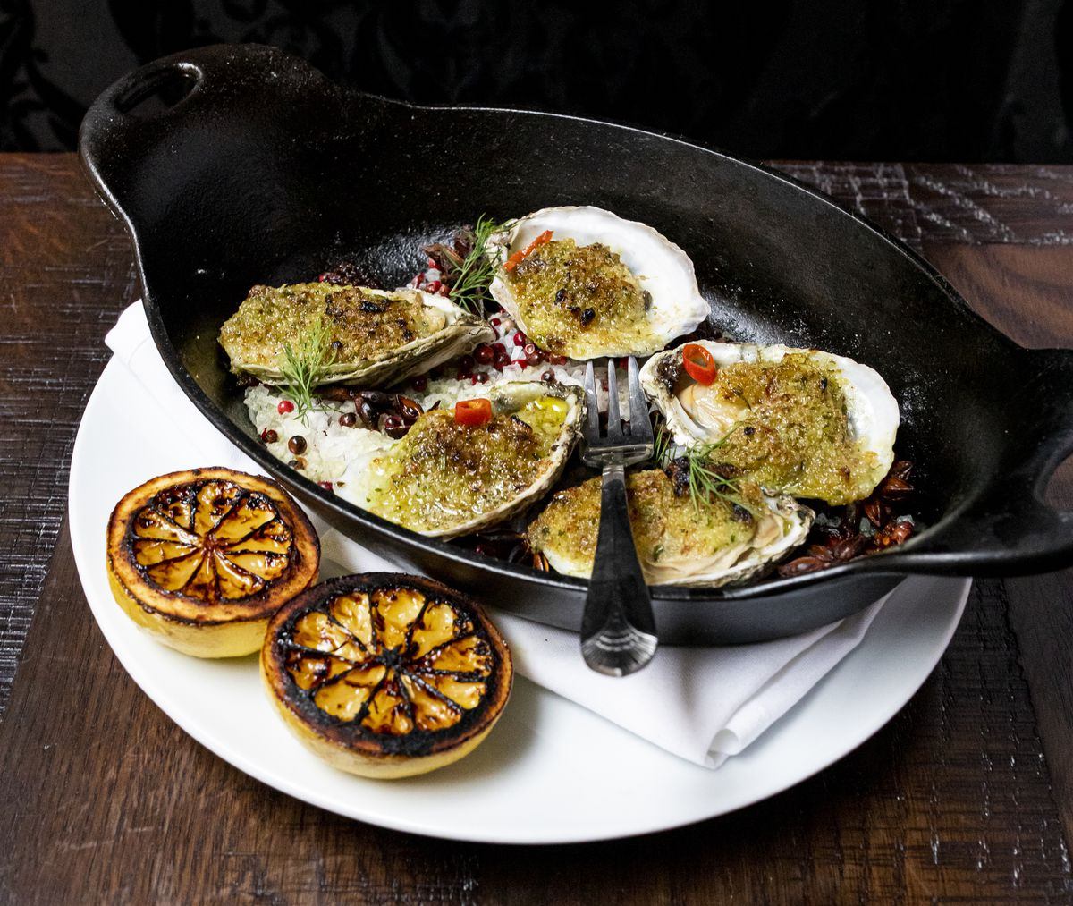 Coal roasted oysters with Pernod garlic butter, bread crumbs, and charred lemon at the Partisan