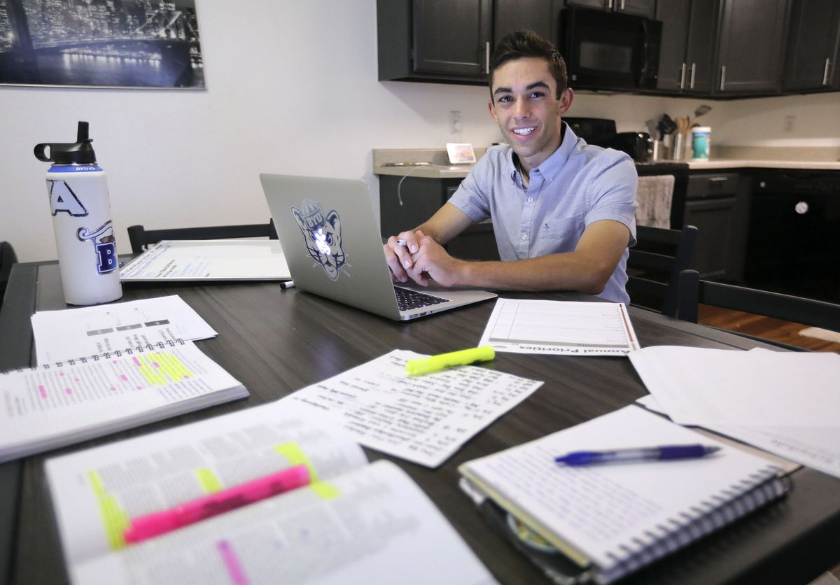 Austin Rustand poses for a portrait at his kitchen table, where he studies and works on job prospects, in Provo on Monday, June 29, 2020. Rustand is trying to get ahead of school work for his junior year at BYU as well as trying to find a job after losing his last one due to the COVID-19 pandemic.