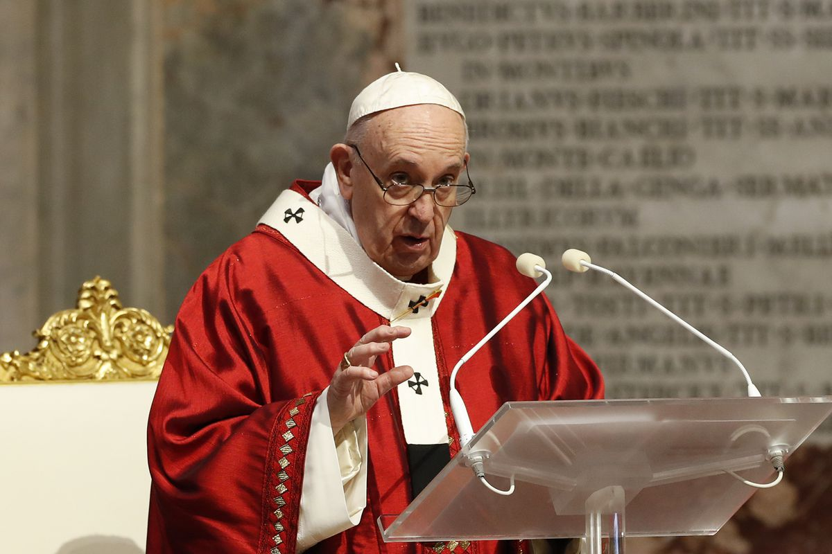Pope Francis celebrates Mass in St. Peter's Basilica at the Vatican, Sunday, May 31, 2020. Francis celebrates a Pentecost Mass in St. Peter's Basilica on Sunday, albeit without members of the public in attendance.