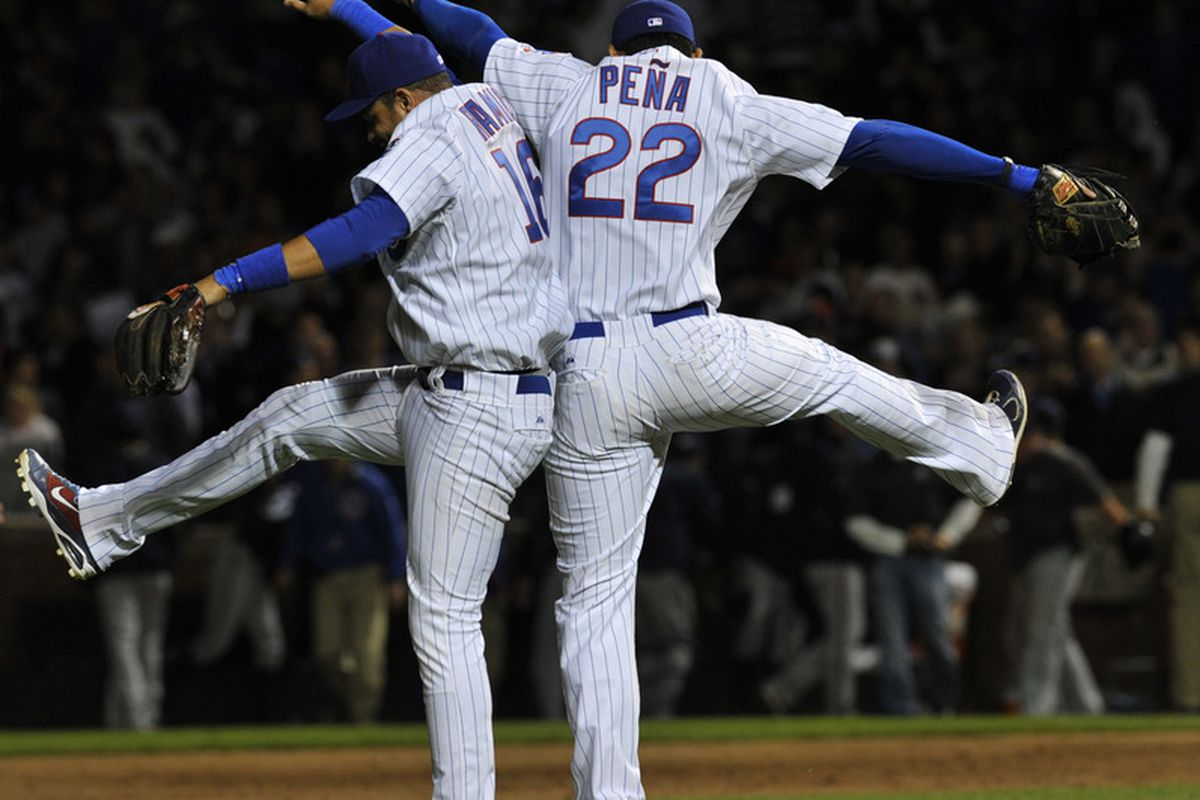Aramis Ramirez of the Chicago Cubs and Carlos Pena celebrate the Cubs victory against the Milwaukee Brewers on June 13, 2011 at Wrigley Field in Chicago, Illinois. The Cubs defeated the Brewers 1-0.  (Photo by David Banks/Getty Images)