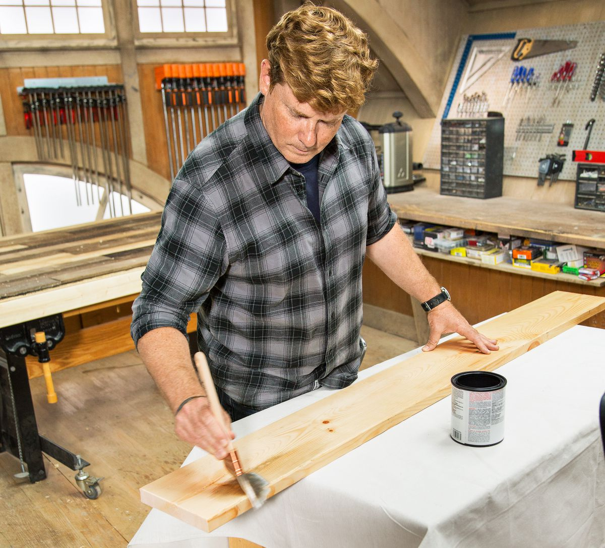 Kevin O'Connor Applies Wood Accelerator On Headboard