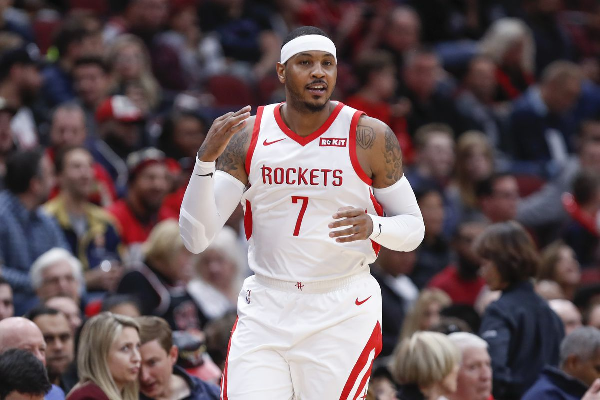 Houston Rockets forward Carmelo Anthony reacts after scoring a three pointer against the Chicago Bulls during the first half at United Center.