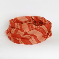 Watercolor Stripe Scarf, Kelly Wearstler, $215<br />These scarves add a cool, boho vibe to any outfit and are available in a variety of gorgeous prints and colors. Wear over a simple white tee and jeans, or with your favorite coat
