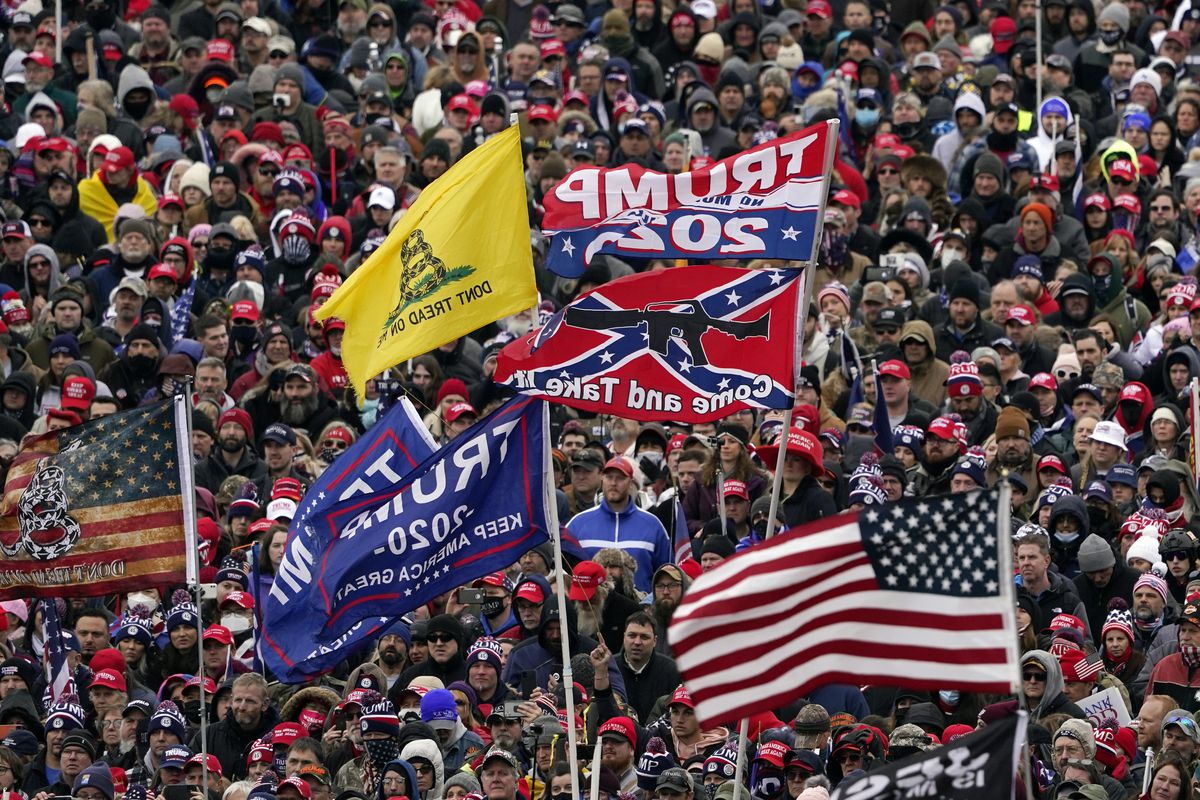 Supporters listened Jan. 6 as President Donald Trump spoke to the flag-bearing crowd near the White House.
