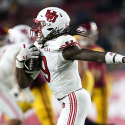 Utah safety Vonte Davis (9) runs back with an intercepted pass during the second half of an NCAA college football game against Southern California, Saturday, Oct. 9, 2021, in Los Angeles.