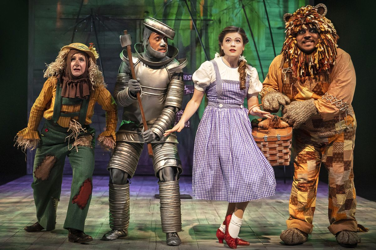"""TheScarecrow (MaryaGrandy, from left), The Tin Man (Joseph Anthony Byrd), Dorothy (LerynTurlington), and The Cowardly Lion (Jose Antonio Garcia) in a scene from Chicago Shakespeare Theater's production of""""TheWizard ofOz"""
