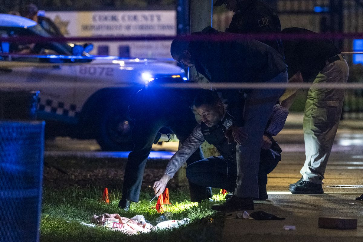 Chicago police work the scene where 3 people were shot, including 1 person who was shot and killed, in the 2700 block of South California Avenue, in the Little Village neighborhood, Saturday, July 10, 2021.