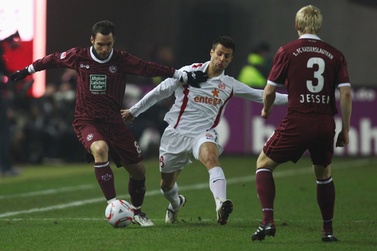 KAISERSLAUTERN GERMANY - JANUARY 29: Marco Caligiuri (R) of Mainz is challenged by Christian Tiffert (L).  (Photo by Alex Grimm/Bongarts/Getty Images)