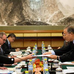 Chinese State Councilor Dai Bingguo, right,  hands a letter to U.S. Secretary of State Hillary Rodham Clinton, left,  during a bilateral meeting at the Diaoyutai State Guesthouse in Beijing, China, on Wednesday, Sept. 5, 2012.