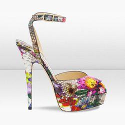 "<b>Jimmy Choo</b> Lola Floral Printed Python Platform Peep Toe Sandal, <a href=""http://us.jimmychoo.com/en/us/spring-summer-13/lola/invt/131lolamfpo/#"">$1495</a>"