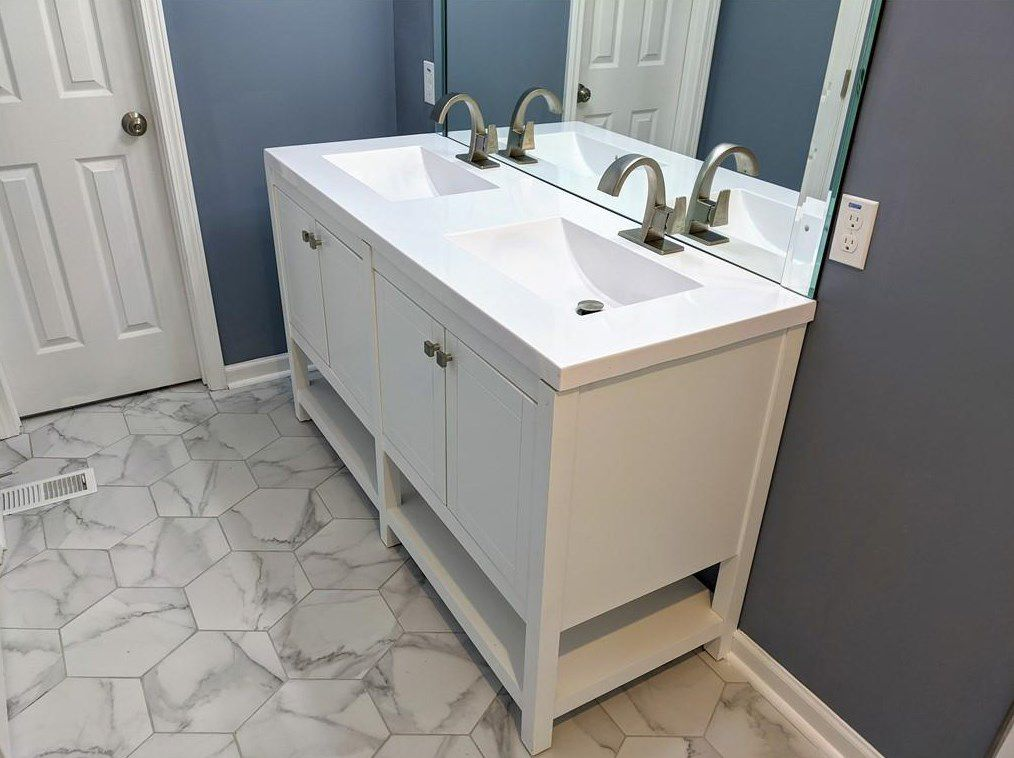 A blue and white bathroom with hexagonal flooring.