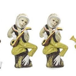 The band's all here! Quit monkeying around and place your $400 bid on these majolica figurines of musical primates.