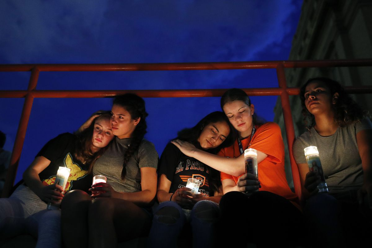From left, Melody Stout, Hannah Payan, Aaliyah Alba, Sherie Gramlich and Laura Barrios comfort each other during a vigil for victims of the shooting Saturday, Aug. 3, 2019, in El Paso, Texas. A young gunman opened fire in an El Paso, Texas, shopping area