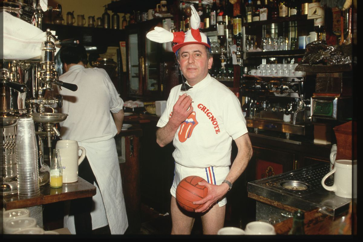 Man with a Basketball in a Restaurant