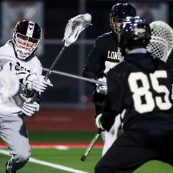 American Fork's Camden Oswald scores on Lone Peak goalie Landon Peterson, Oswald's third goal of the night, in a boys lacrosse game in American Fork on Tuesday, March 30, 2021.