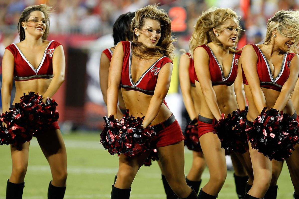 TAMPA, FL - AUGUST 27:  The cheerleaders of the Tampa Bay Buccaneers perform during a preseason game against the Miami Dolphins at Raymond James Stadium on August 27, 2011 in Tampa, Florida.  (Photo by J. Meric/Getty Images)