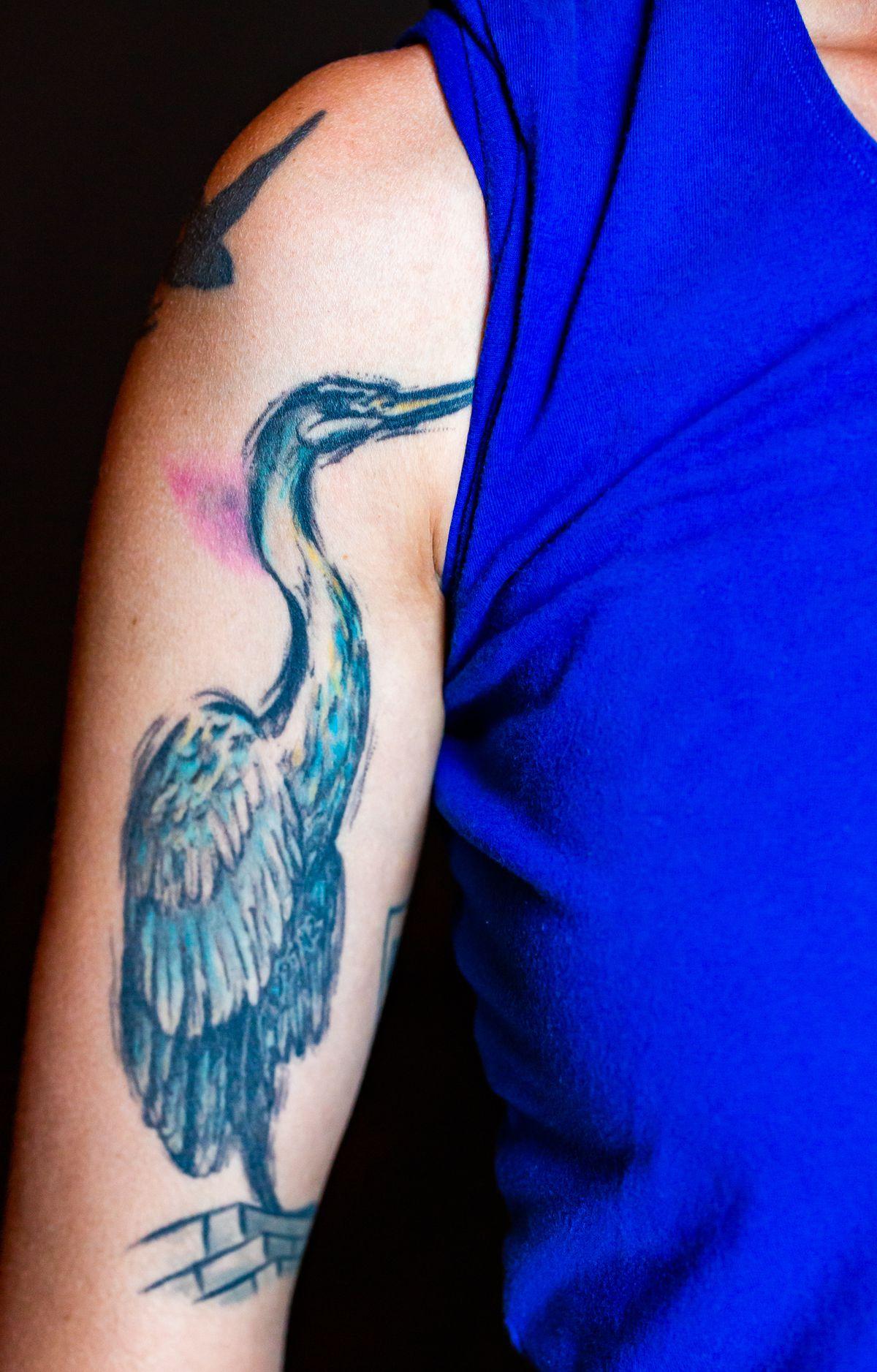 Jen Hidinger-Kendrick's right arm with a crane tattoo