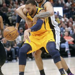 Utah Jazz center Rudy Gobert (27) loses the ball as San Antonio Spurs center Trey Lyles (41) grabs him during an NBA game at Vivint Arena in Salt Lake City on Friday, Feb. 21, 2020. The Jazz lost 104-113.