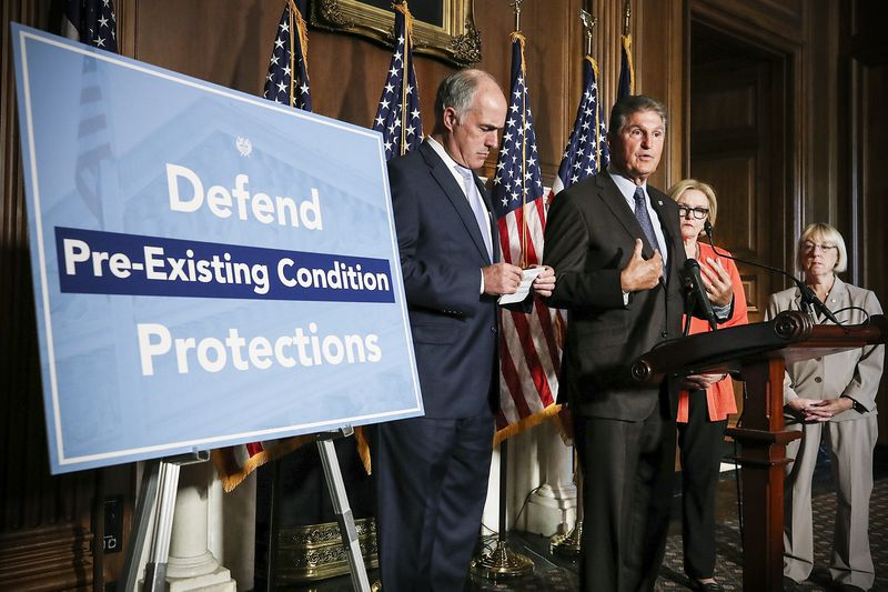 Sen. Joe Manchin (D-WV) discusses a proposed protection plan for people with pre-existing health conditions, alongside Sen. Bob Casey (D-PA) and Sen. Claire McCaskill ((D-MO) on Capitol Hill, on July 19, 2018.