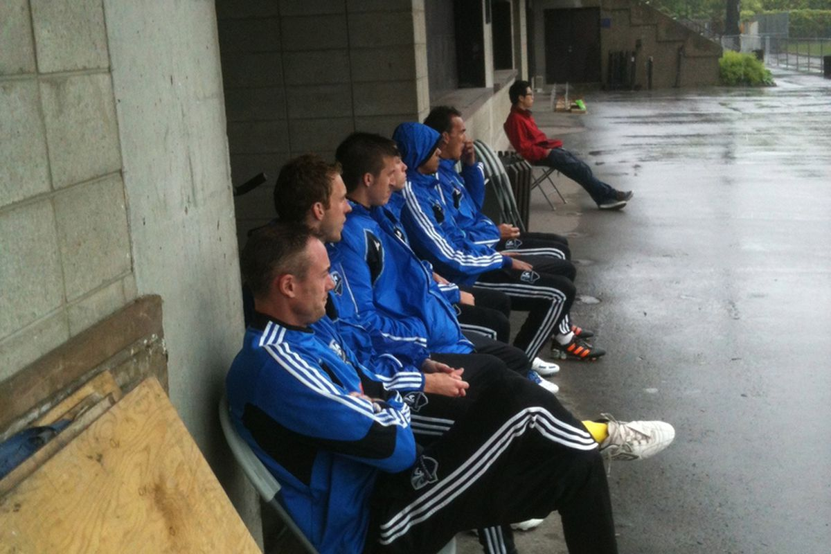 The Montreal Impact bench watch their teammates play in the confort of a dry spot at Complexe Sportif Claude Robillard.
