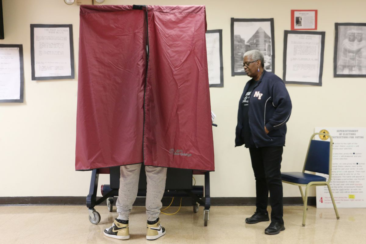 A voter casts his ballot in Newark's Central Ward on Tuesday.