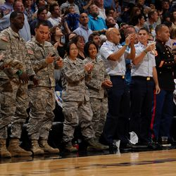 Military personnel cheering courtside at the Magic vs. Suns matchup on November 4 as part of the Magic's Seats for Soldiers Night presented by Harris Corporation.