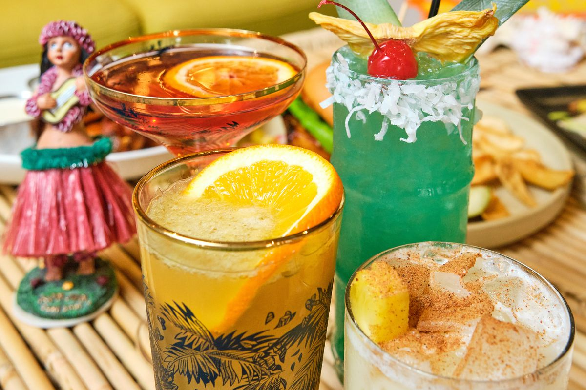 Four cocktails with hula dancer