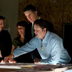 """Cameron Oscarson, Anne Arendt, Utah Valley University President Matthew Holland, and Tom and Gayle Holdman look at a section of the stained-glass project called """"Roots of Knowledge"""" at Holdman Studios at Thanksgiving Point in Lehi on Friday, Sept. 16, 2016. A Guardian UK reporter called the work """"one of the most spectacular stained glass windows made in the past century."""""""