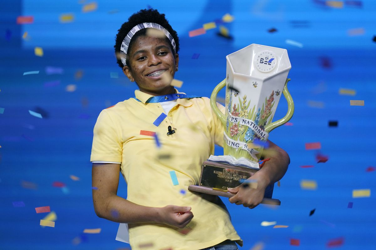 Zaila Avant-garde, 14, from Harvey, Louisiana celebrates with the championship trophy after winning the finals of the 2021 Scripps National Spelling Bee at Disney World Thursday, July 8, 2021, in Lake Buena Vista, Fla.