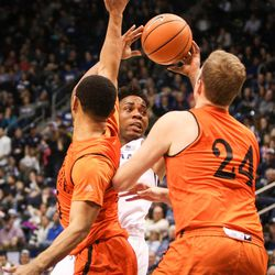 Brigham Young Cougars guard Jahshire Hardnett (0) gets into trouble because of the defense of Idaho State Bengals forward Blake Truman (24) and guard Brandon Boyd (15) and looks to offload as BYU takes on Idaho State at the Marriott Center in Provo on Thursday, Dec. 21, 2017.