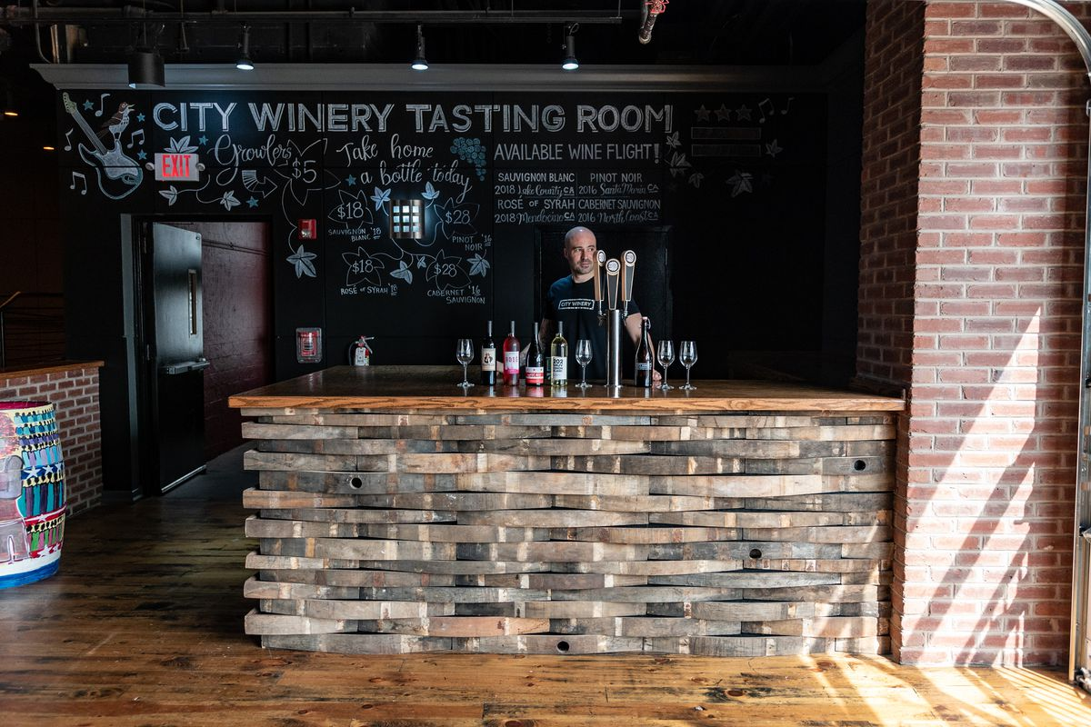 City Winery's new tasting bar is built out of reclaimed wood from salvaged barrels.