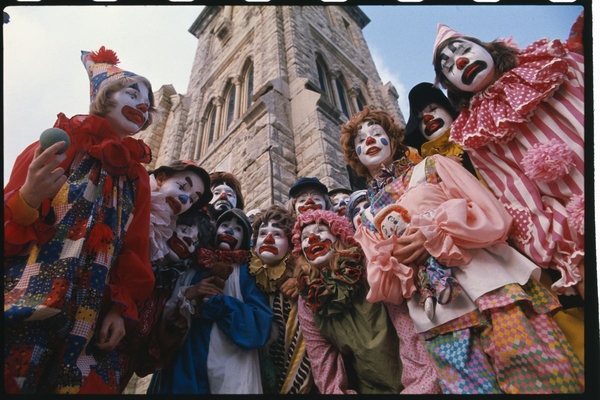 Group of Clowns Standing Outside a Church