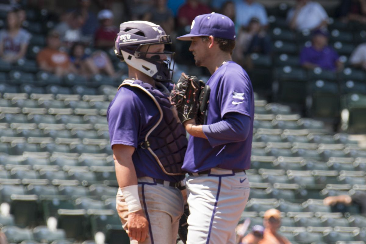 Evan Skoug chats up Jared Janzack at the mound during Saturday's game against Texas