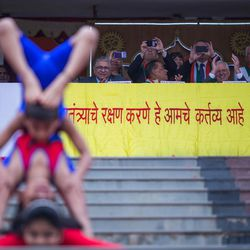Students perform yogasanas during the 71st Independence Day celebrations at the MIT World Peace University in Pune, Maharashtra, India, on August 15, 2017.