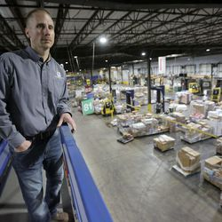 Justin Johnson, Associated Foods Farr West general manager, looks out over the Associated Foods Stores distribution warehouse in Farr West, Weber County, on Tuesday, March 17, 2020.