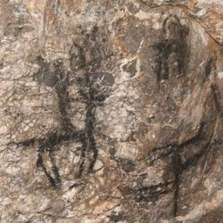 Indian pictographs inside  Jukebox Cave show tiny figures on horseback wielding spears and lances.