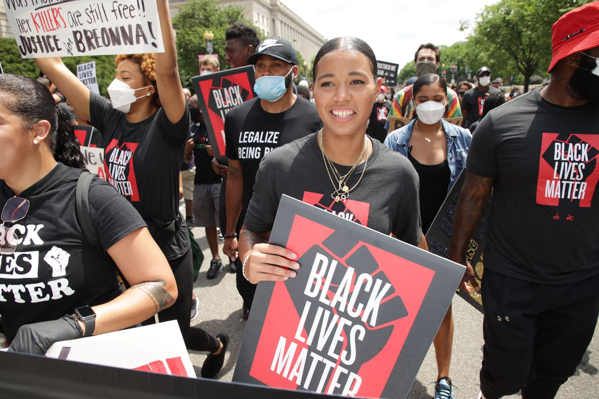 "Natasha Cloud marches in a ""Black Lives Matter"" parade."