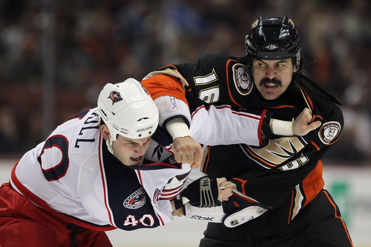 ANAHEIM CA - JANUARY 07:  George Parros #16 of the Anaheim Ducks throws a punch at Jared Boll #40 of the Columbus Blue Jackets in the first period at the Honda Center on January 7 2011 in Anaheim California.  (Photo by Jeff Gross/Getty Images)