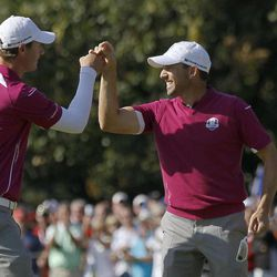 Europe's Nicolas Colsaerts, left, and Sergio Garcia celebrate after Colsaerts made a birdie putt on the 11th hole during a foursomes match at the Ryder Cup PGA golf tournament Saturday, Sept. 29, 2012, at the Medinah Country Club in Medinah, Ill.