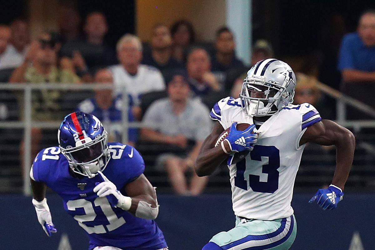 Jabrill Peppers of the New York Giants pursues Michael Gallup of the Dallas Cowboys in the fourth quarter at AT&T Stadium on September 08, 2019 in Arlington, Texas.