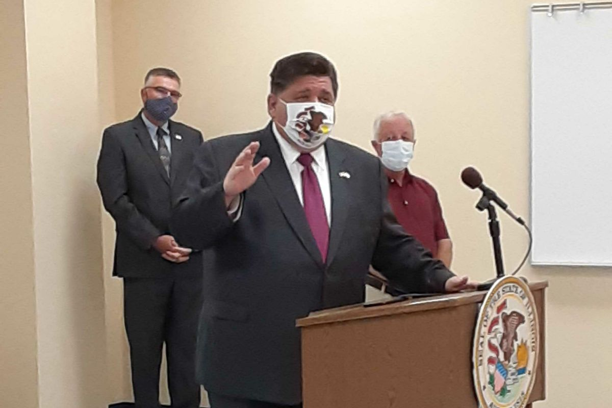 Gov. J.B. Pritzker speaks at a news conference at the Adams County Public Health Department in Quincy in July.