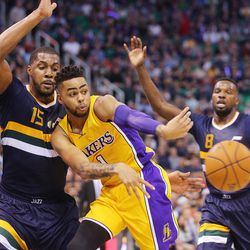 Former Los Angeles Lakers guard D'Angelo Russell (1) passes away from the defense of Utah Jazz forward Derrick Favors (15) as the Utah Jazz open the home season with the LA Lakers in Salt Lake City on Friday, Oct. 28, 2016.